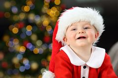Kid looking at camera in christmas wearing santa disguise stock images