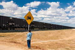 Kid looking at the Cerrejon train. Driving through Guajira Desert, Colombia Royalty Free Stock Photography
