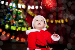 Kid looking at Christmas ball Stock Photography