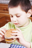 Kid looking at hamburger Royalty Free Stock Photography