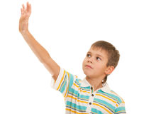 Kid looking at his risen up hand Stock Photos