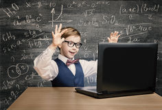 Kid Looking at Laptop, Child with Notebook, Little Boy Formula. Kid Looking at Laptop, Child with Notebook, Little Boy Mathematics Formula on Black Chalkboard stock photos