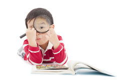 Kid looking through from magnifying glass Royalty Free Stock Image