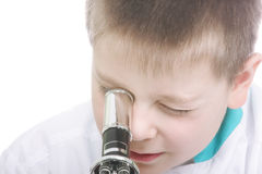 Kid looking into microscope closeup Royalty Free Stock Photography