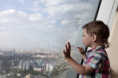 Kid looking at Moscow Stock Photography