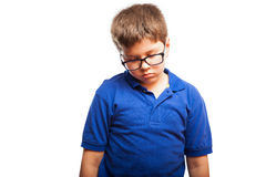 Kid looking sad and lonely. Studio portrait of a little boy with glasses looking all sad and lonely Royalty Free Stock Image