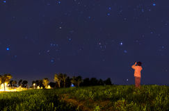Kid looking at the stars. With binoculars Royalty Free Stock Photography