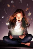 Kid looking at tablets Royalty Free Stock Images
