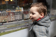 Kid looking at toy city Royalty Free Stock Images