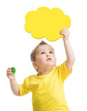 Kid looking up with blank yellow cloud in hand Royalty Free Stock Image