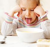 Kid looks with disgust for food Stock Photos