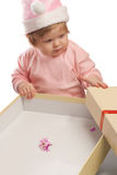 Kid looks at empty present box Royalty Free Stock Image