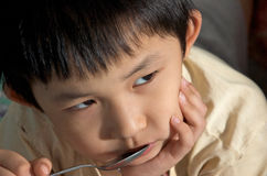 Kid lost appetite. Asian Kid lost appetite for his breakfast , close up Royalty Free Stock Photos