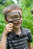 Kid with loupe Royalty Free Stock Image