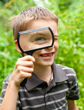 Kid with loupe Royalty Free Stock Images