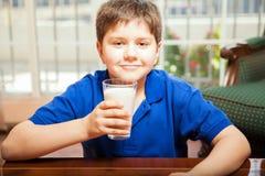 Kid loves drinking milk Royalty Free Stock Photos