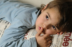 Kid lying in the bed Stock Photography