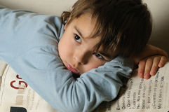 Kid lying in the bed Stock Images