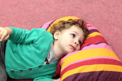 Kid is lying on carpet Stock Image