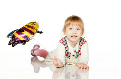 Kid lying on the floor with balloon bee Stock Photos