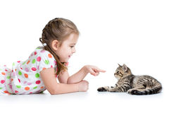 Kid lying on floor and playing with cat Stock Photography
