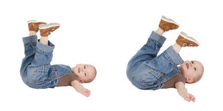 Kid is lying with lifted legs Stock Photography