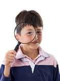Kid with magnifying glass Stock Image