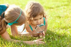 Kid with magnifying glass Royalty Free Stock Photo