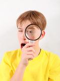 Kid with Magnifying Lens Royalty Free Stock Photo