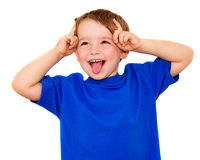 Kid making funny expression. Isolated on white Royalty Free Stock Photo