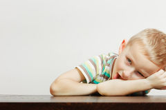 Kid making funny faces being bored Stock Photo