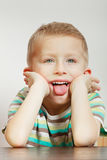 Kid making funny faces being bored Royalty Free Stock Image