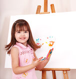 Kid making handprints with paint. Little girl making handprints with paint stock photography