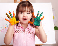 Kid making handprints with paint. Little girl making handprints with paint stock images