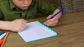 Kid making homework stock video
