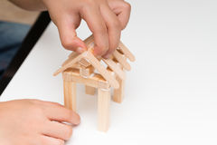 Kid making a house model. At home royalty free stock photography