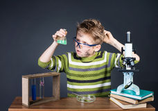 Kid making science experiments. Crazy funny dirty scientist. Education and science concept. stock image