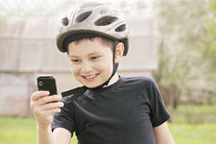 Kid making shot with phone Stock Photos