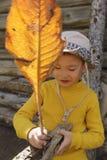 kid making skiff with leaf Royalty Free Stock Image