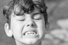 Kid making strange facial expressions Royalty Free Stock Photo