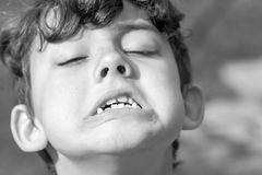Kid making strange facial expressions Stock Image