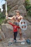 Kid with He-man statue at Ramoji film city, hyderabad Stock Photo