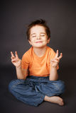 Kid in meditation Royalty Free Stock Photos