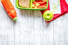 Kid menu lunchbox for school top view on wooden background Royalty Free Stock Photos