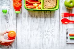 Kid menu lunchbox for school top view on wooden background Royalty Free Stock Image