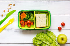 Kid menu lunchbox for school top view on wooden background Stock Photo