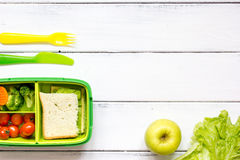 Kid menu lunchbox for school top view on wooden background Stock Image