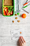 Kid menu lunchbox for school top view on wooden background. Kid menu lunchbox for school with vegetables and fruit to school top view on wooden background Stock Photography