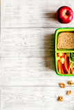Kid menu lunchbox for school top view on wooden background Stock Images