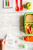 Kid menu lunchbox for school top view on wooden background Stock Photography